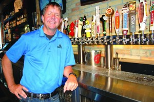 Franchise co-owner John Glockner stands by the tap at the JL Beers restaurant in northeast Minneapolis. Glockner and his partners are opening a second location in Burnsville. (Photo by John Gessner)